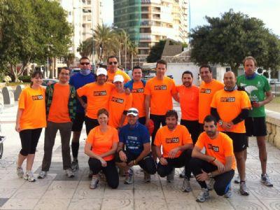 Los corredores malagueños de la Marea Naranja, después de no de sus entrenamientos